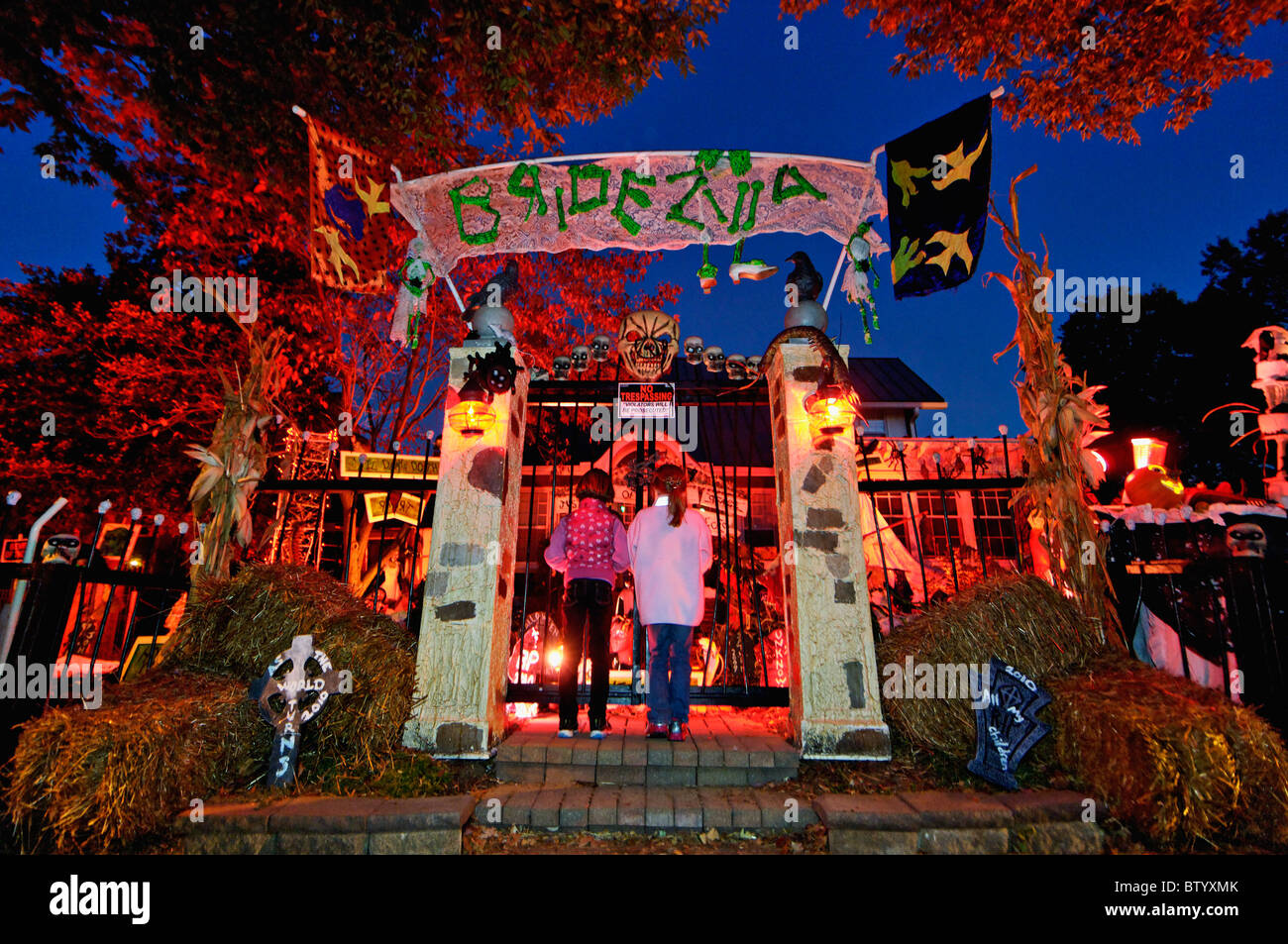 Children Looking At House Decorated For Halloween On ...