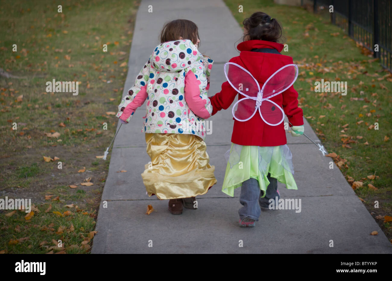Two girls walking in Halloween costumes in Canada - Stock Image & Little Girls Fairy Costumes Stock Photos u0026 Little Girls Fairy ...