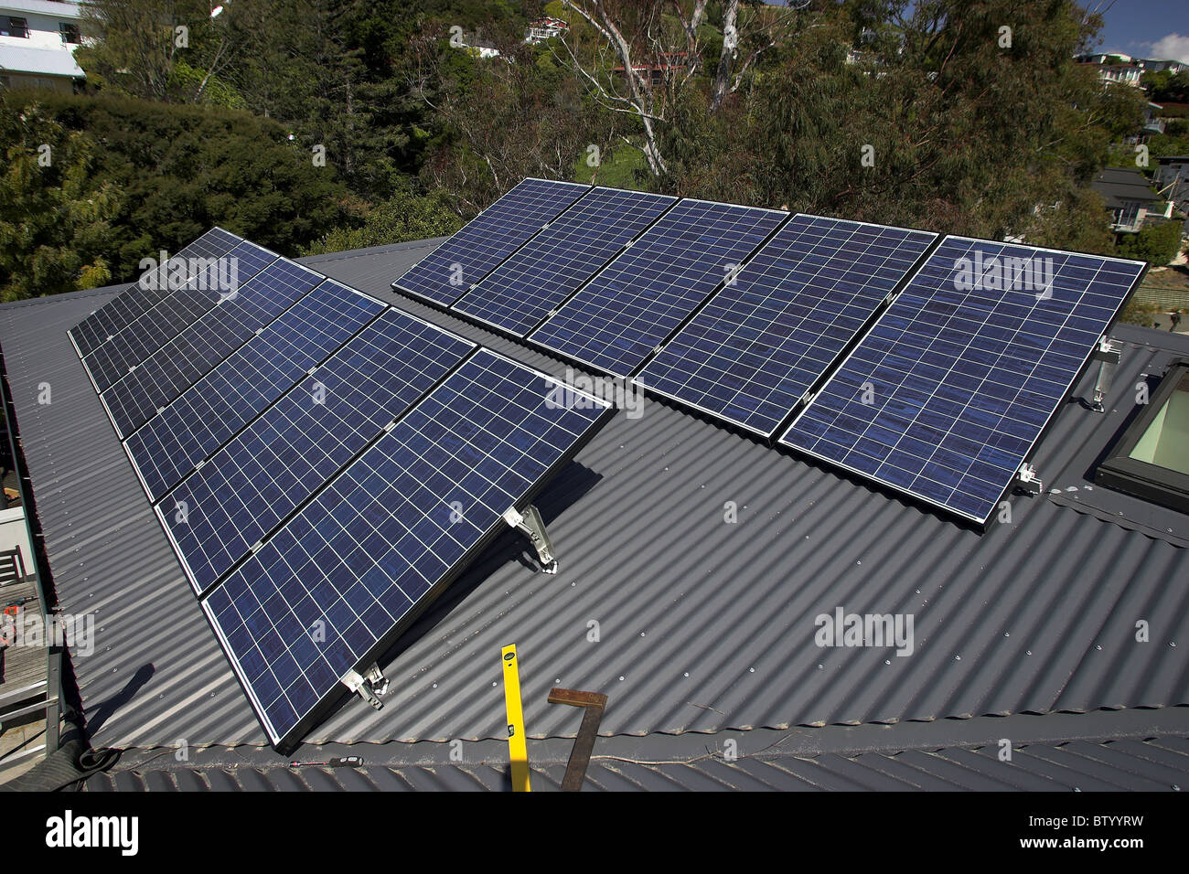 Photovoltaic solar panels on a house in Nelson, the city with New Zealand's highest sunshine hours - Stock Image