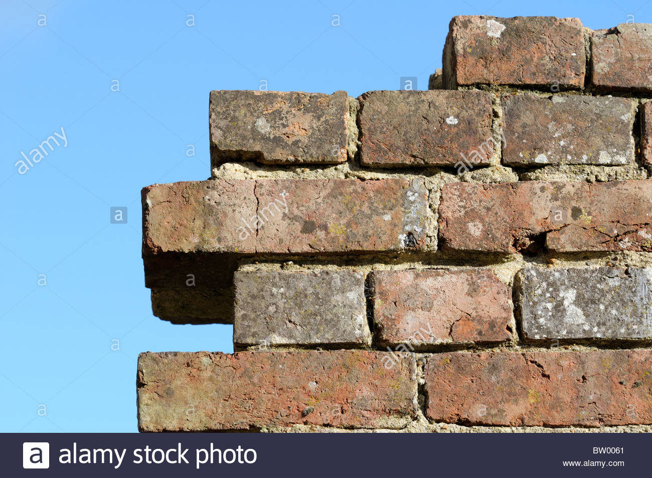 Looking skywards at an old and dilapidated brickwork wall, England UK - Stock Image