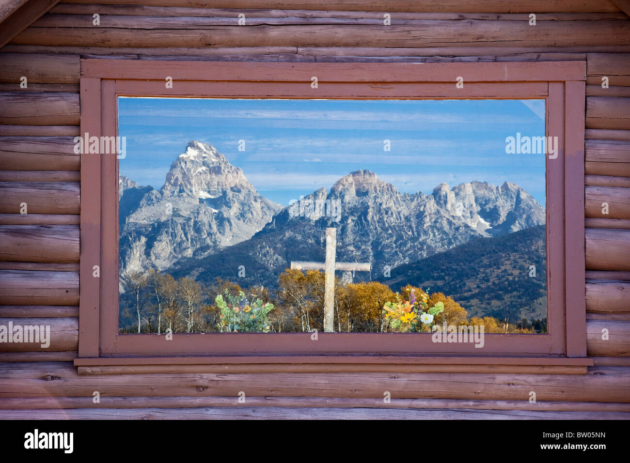 The glorious Grand Teton's reflected in the windows of the little church - Stock Image