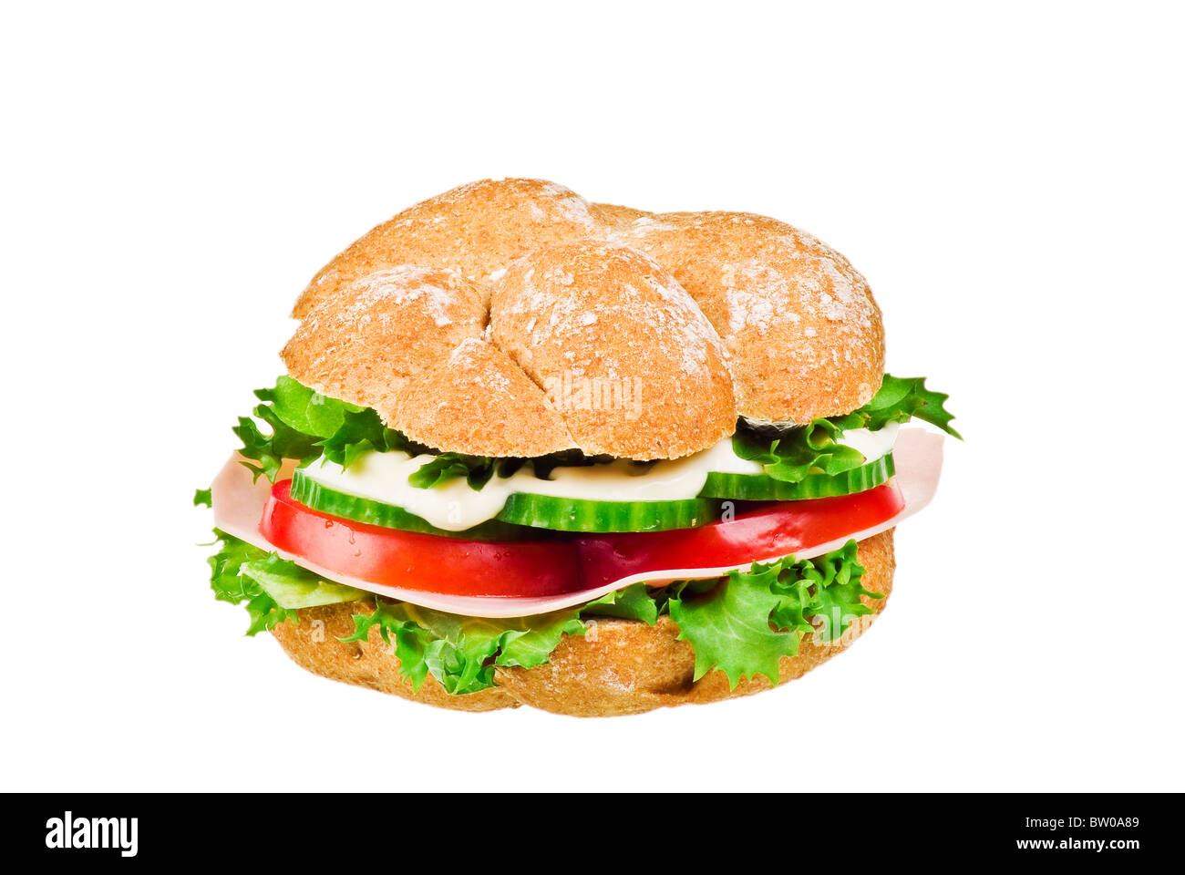 Fresh sandwich with ham and vegetables over white background - Stock Image