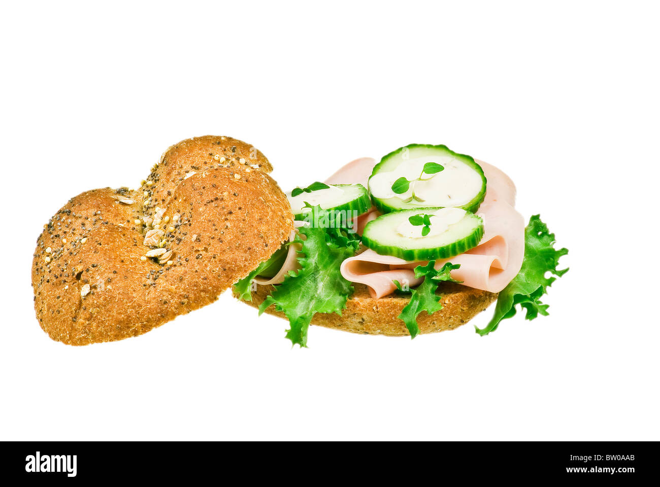 Fresh ham and cucumber sandwich over white background - Stock Image