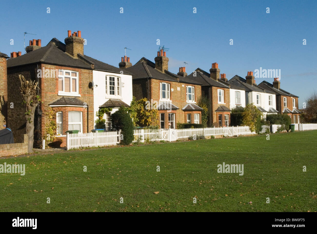 Row of semi detached Edwardian terraced houses Weston Green suburban London Surrey. UK. HOMER SYKES - Stock Image