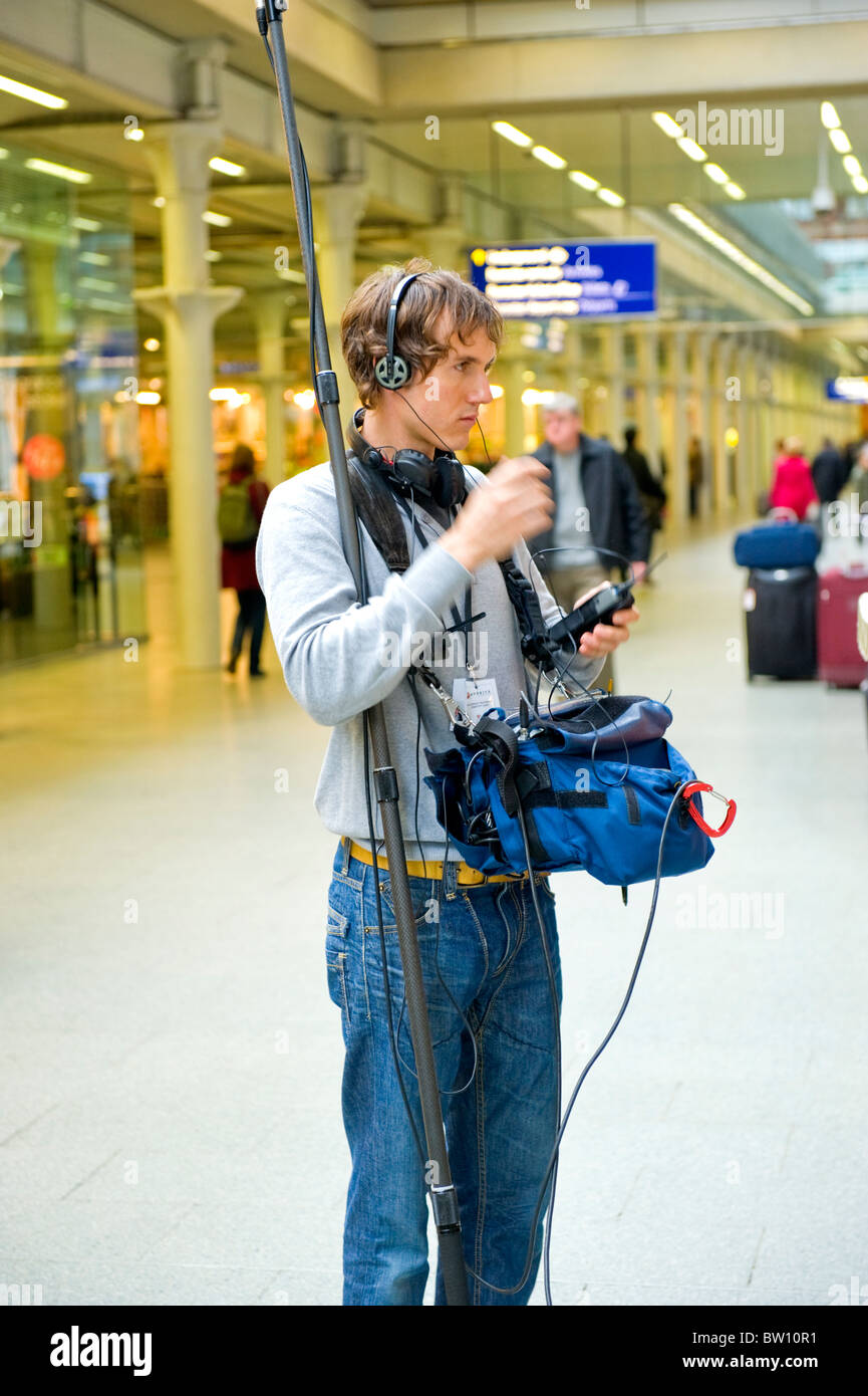 London St Pancras Station sound engineer young man prepares for shoot of a TV program to Ask the Doctor from the - Stock Image