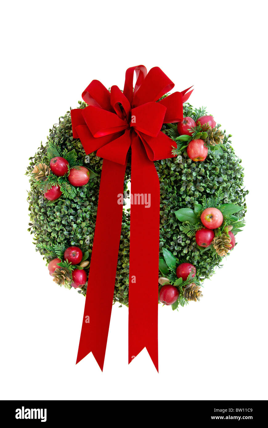 Christmas wreath with red velvet bow isolated on a white background Stock Photo