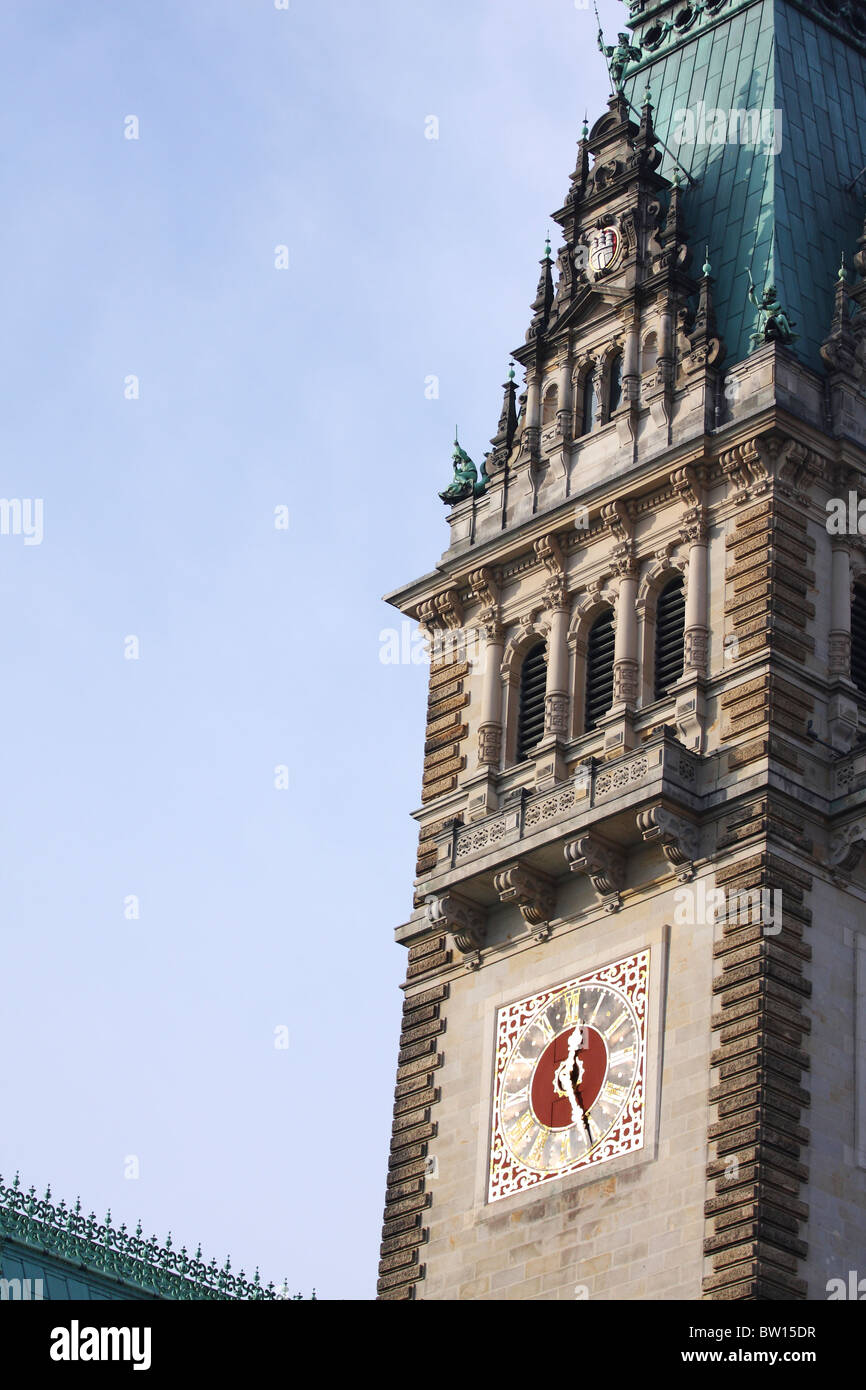 Tight shot of the Hamburg Rathaus, in central Hamburg, where the clock can be seen. - Stock Image