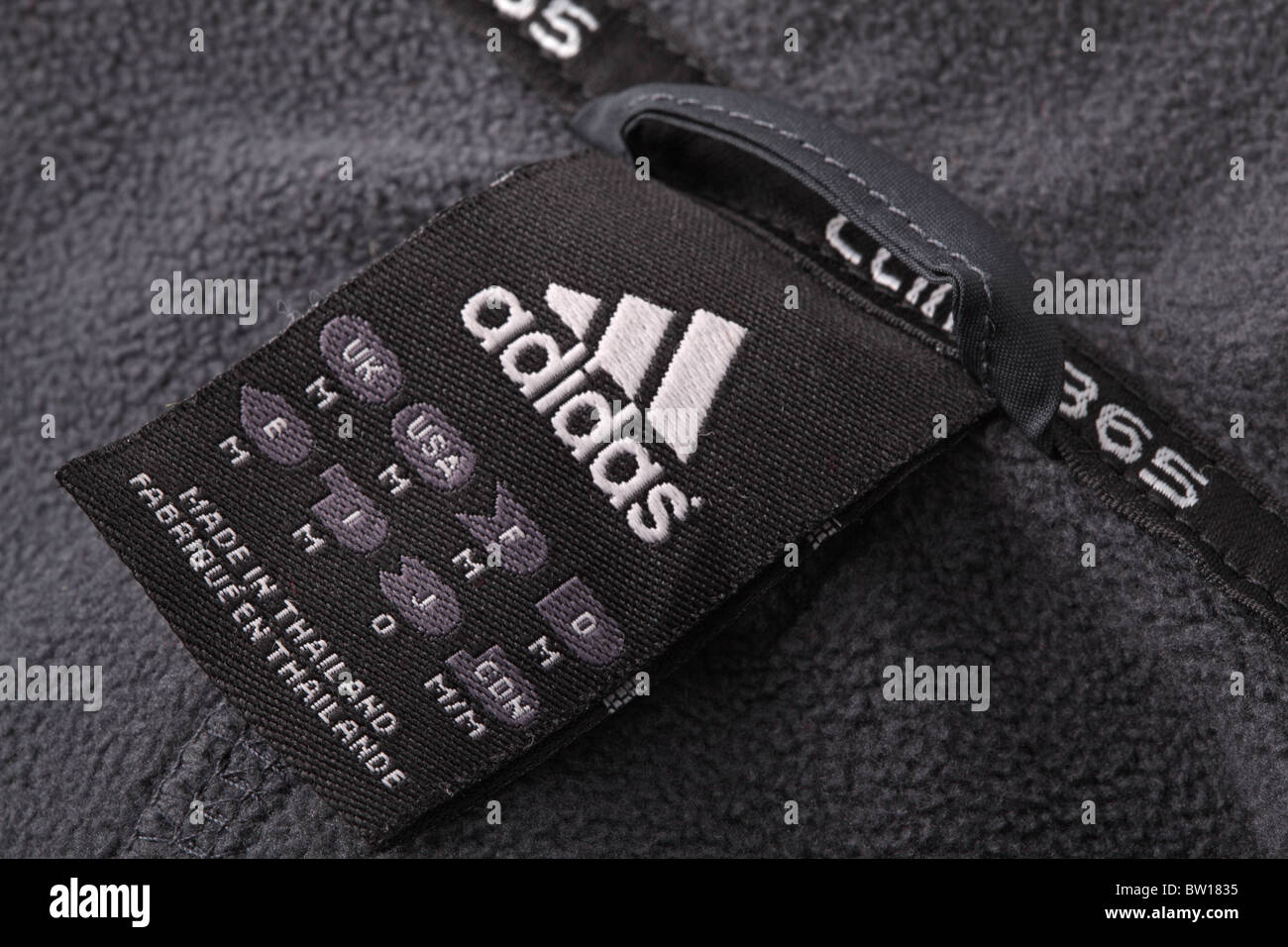Adidas logo on a black jacket label. Shallow DOF. - Stock Image