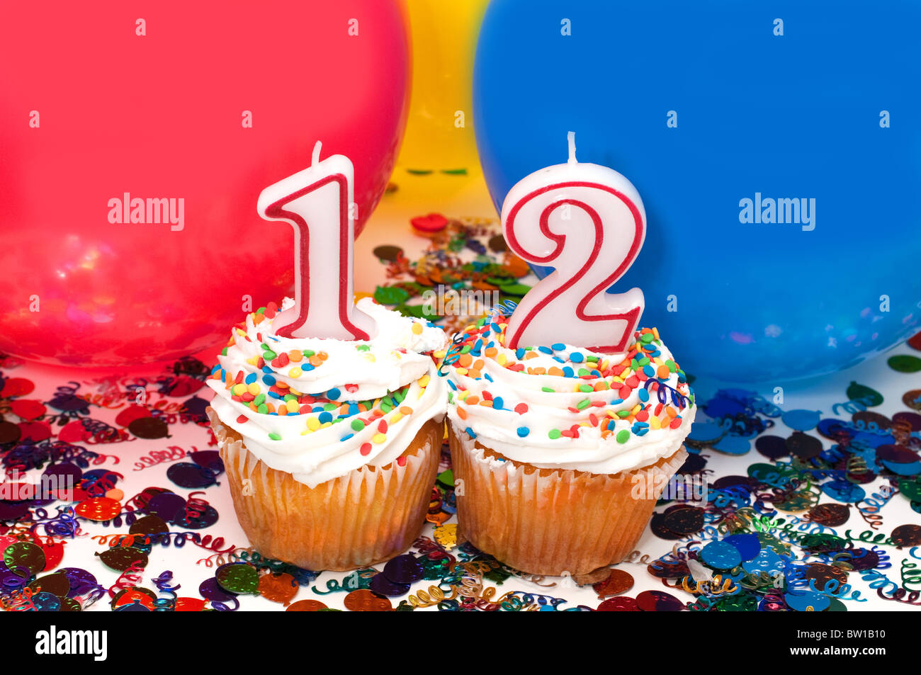 Celebration With Balloons Confetti Cupcake And Number 12 Candle