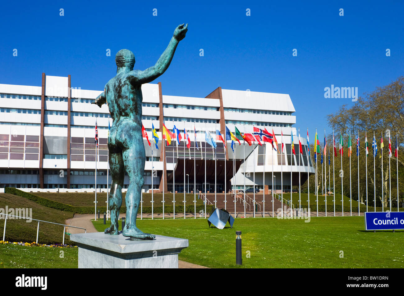 Greek statue of Poseidon - Neptune and Council of Europe building, Palais de l'Europe, Strasbourg, Alsace, France - Stock Image