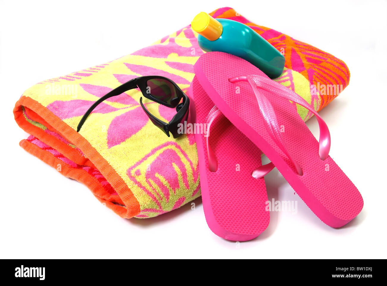 610b772a779d7a Beach towel, flip flops, sunglasses, and sunscreen isolated on white  background. -