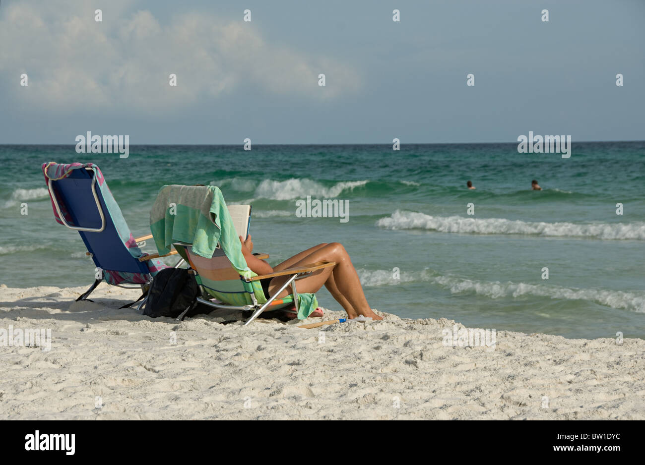 Brilliant A Woman Lounging In A Beach Chair Along The Shore Of The Ocoug Best Dining Table And Chair Ideas Images Ocougorg