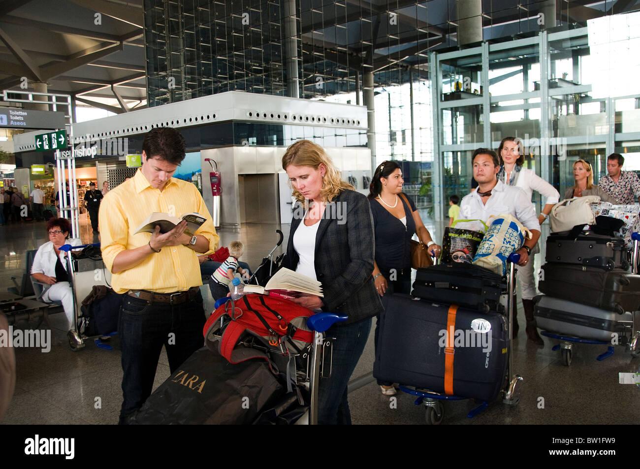 Airport Malaga people waiting luggage Spain Spanish - Stock Image
