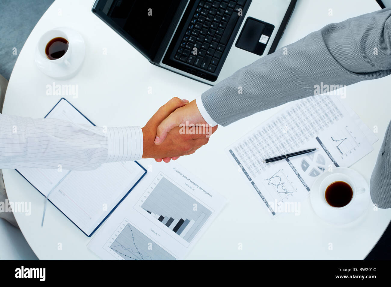 Photo of handshake of business partners after striking deal - Stock Image