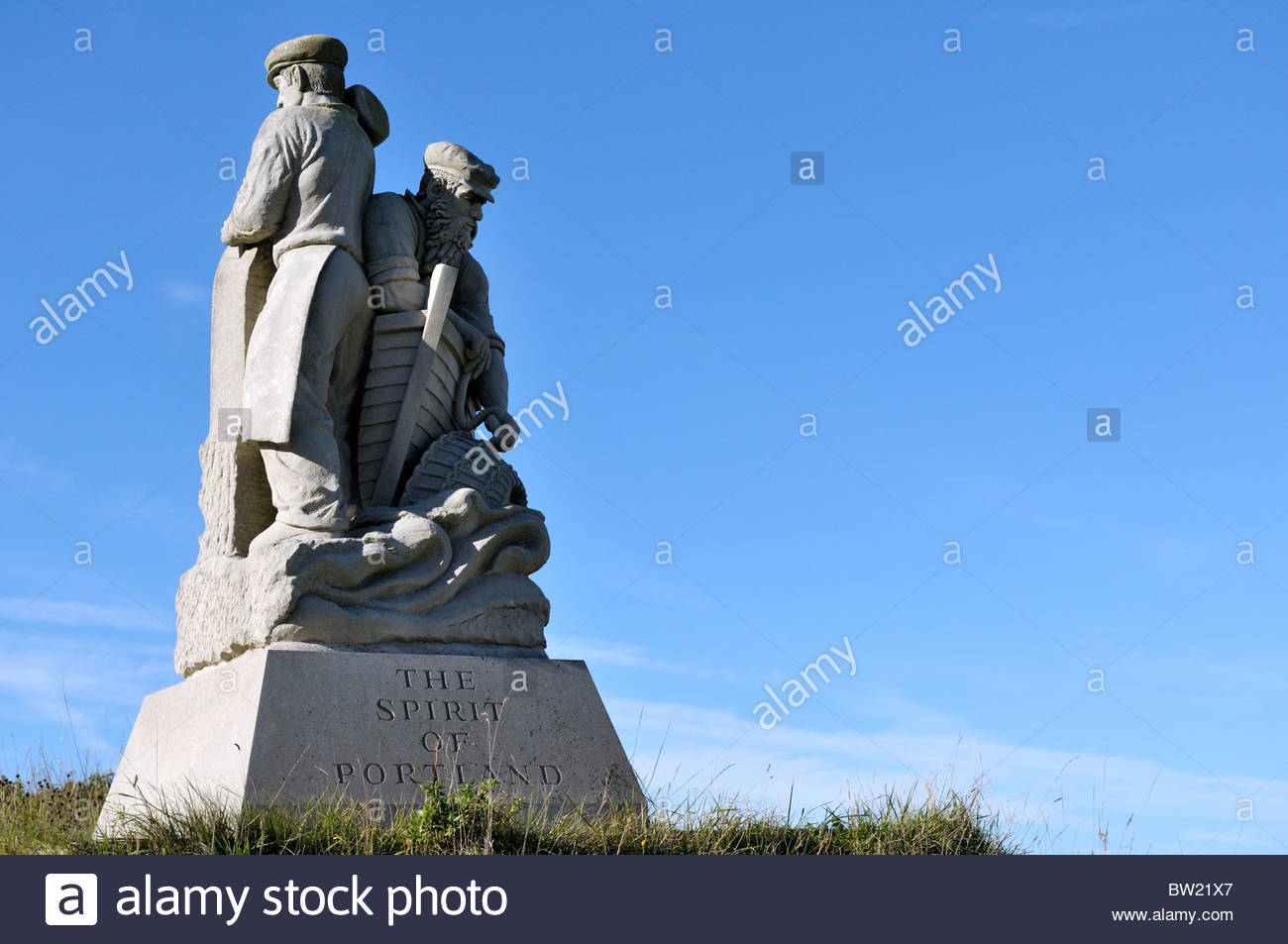 Looking up at the Spirit of Portland statue set against a clear blue sky on Isle of Portland in Dorset, England, - Stock Image