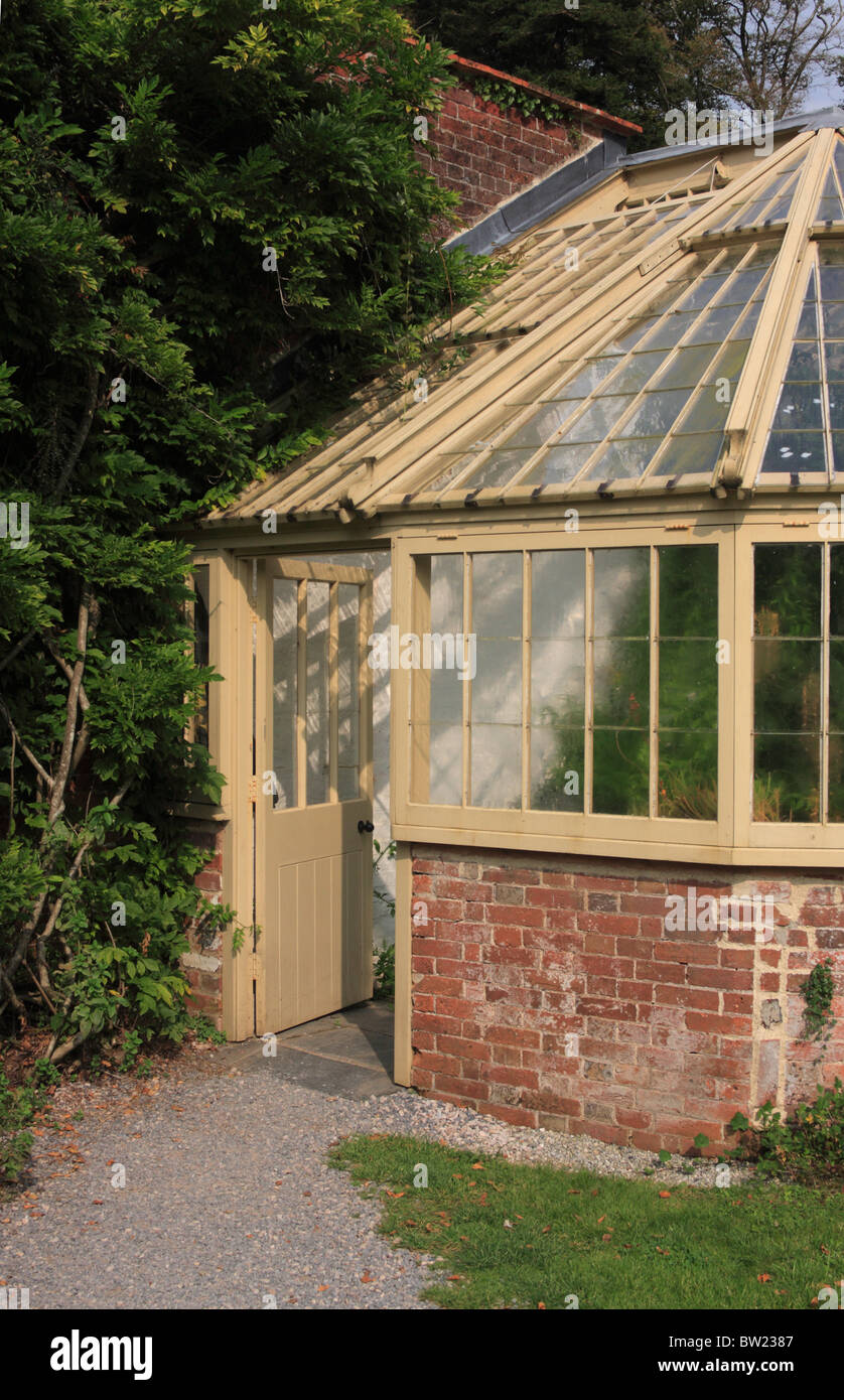 wood and brick greenhouse in gardens at greenway house. Black Bedroom Furniture Sets. Home Design Ideas