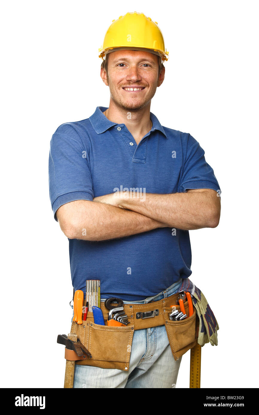 portrait of confident handyman crossed arms isolated on white - Stock Image