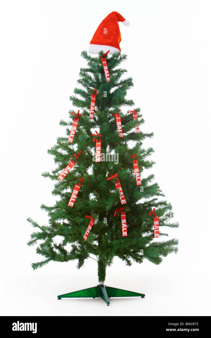 image of christmas fir tree decorated with red labels of sale and santa cap on its top - Decorative Christmas Labels