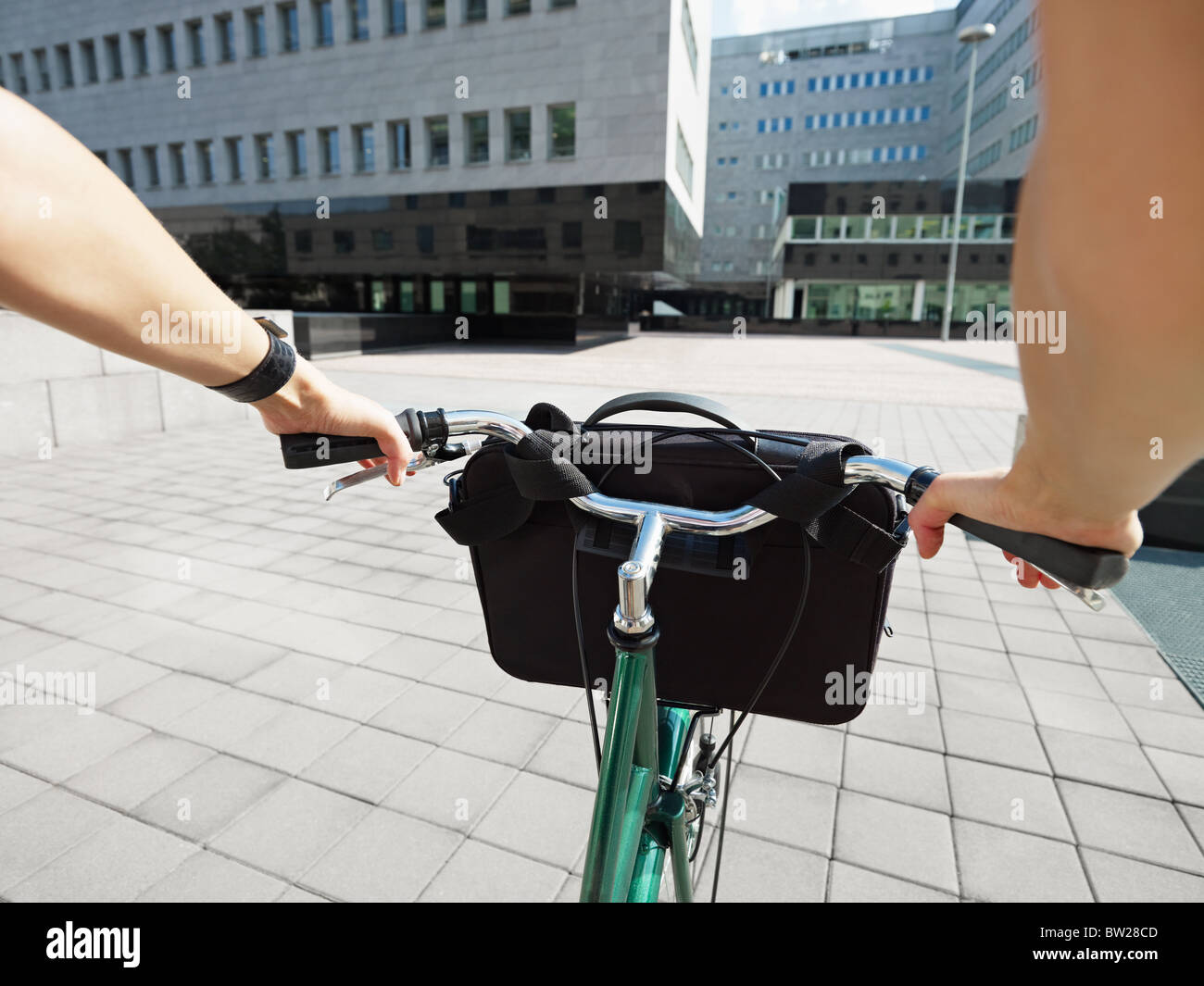 Cropped view of businesswoman going to work by bike - Stock Image