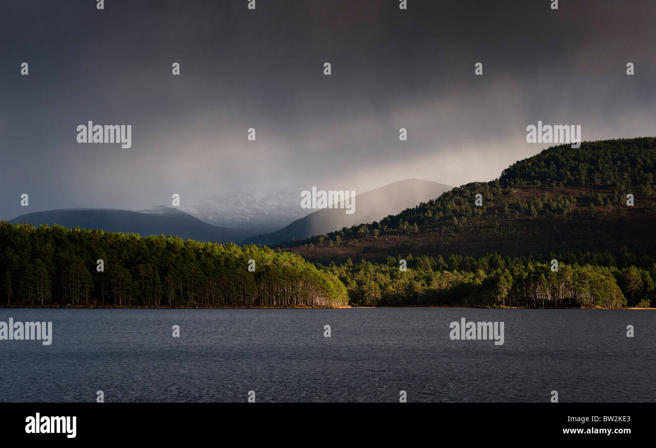 Storm clouds over the Cairngorms and Loch an Eilein - Stock Image