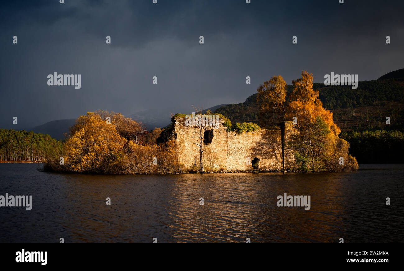The island and castle on Loch an Eilein Cairngorms National Park  in Autumn - Stock Image