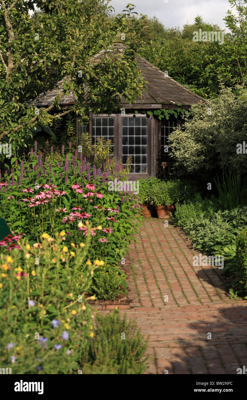Summerhouse Path and herbaceous border in early August at RHS Gardens Royal Horticultural Society garden Rosemoor - Stock Image
