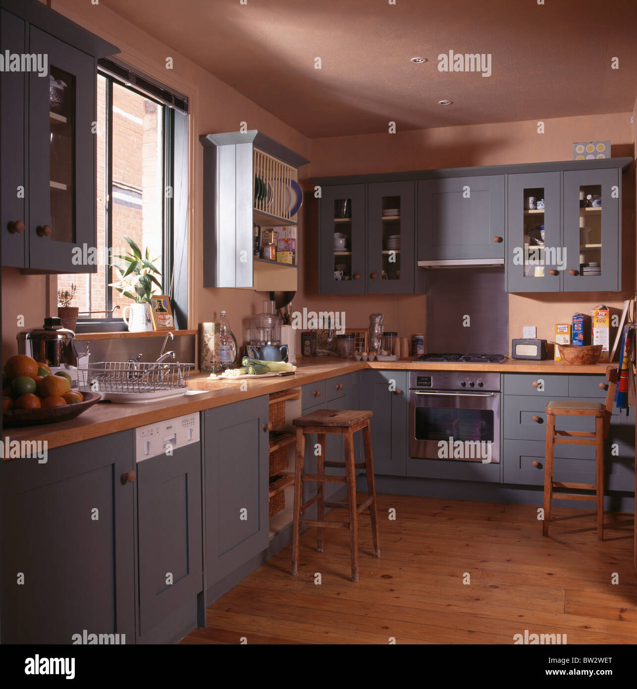 Blue grey fitted units and cupboards in terracotta country for Country kitchen flooring