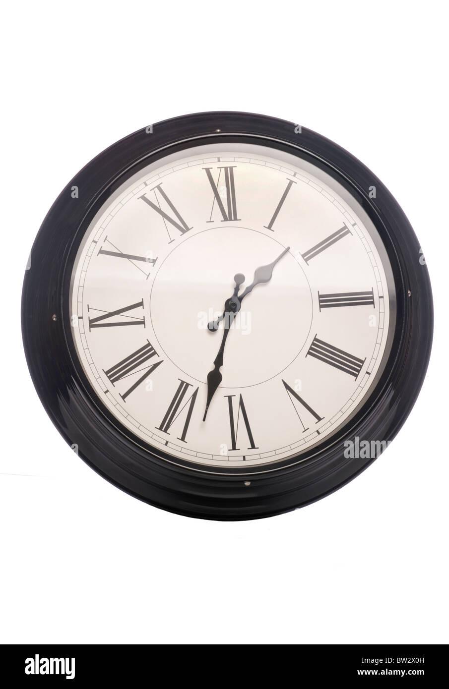 Vintage wall clock studio cutout - Stock Image