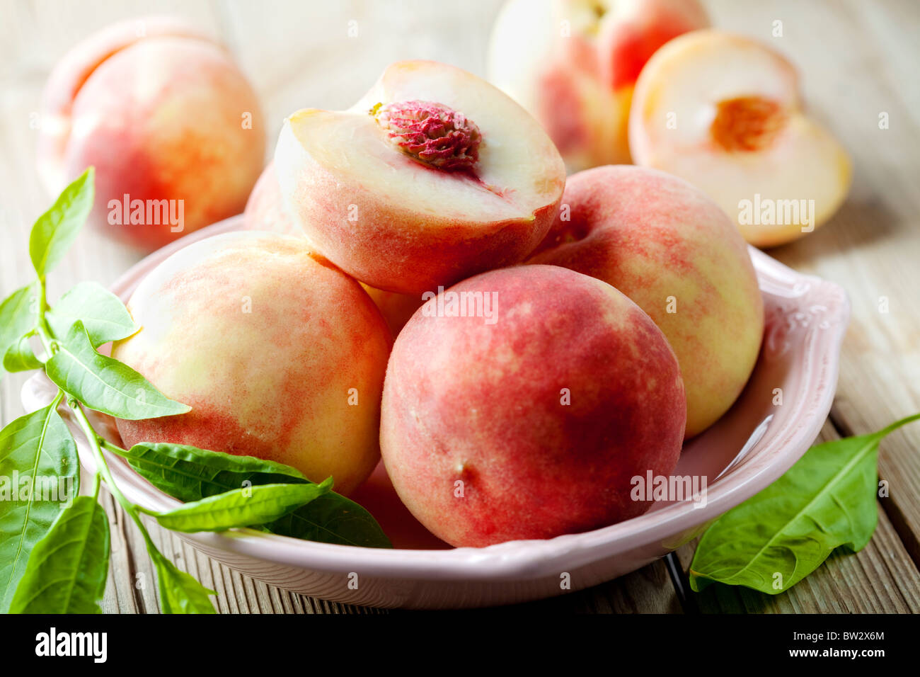 bowl of delicious peaches - Stock Image
