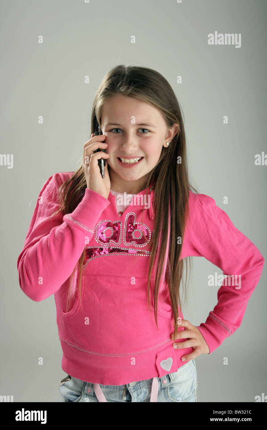 Ten Year Old Girl Talking On A Mobile Phone Stock Photo