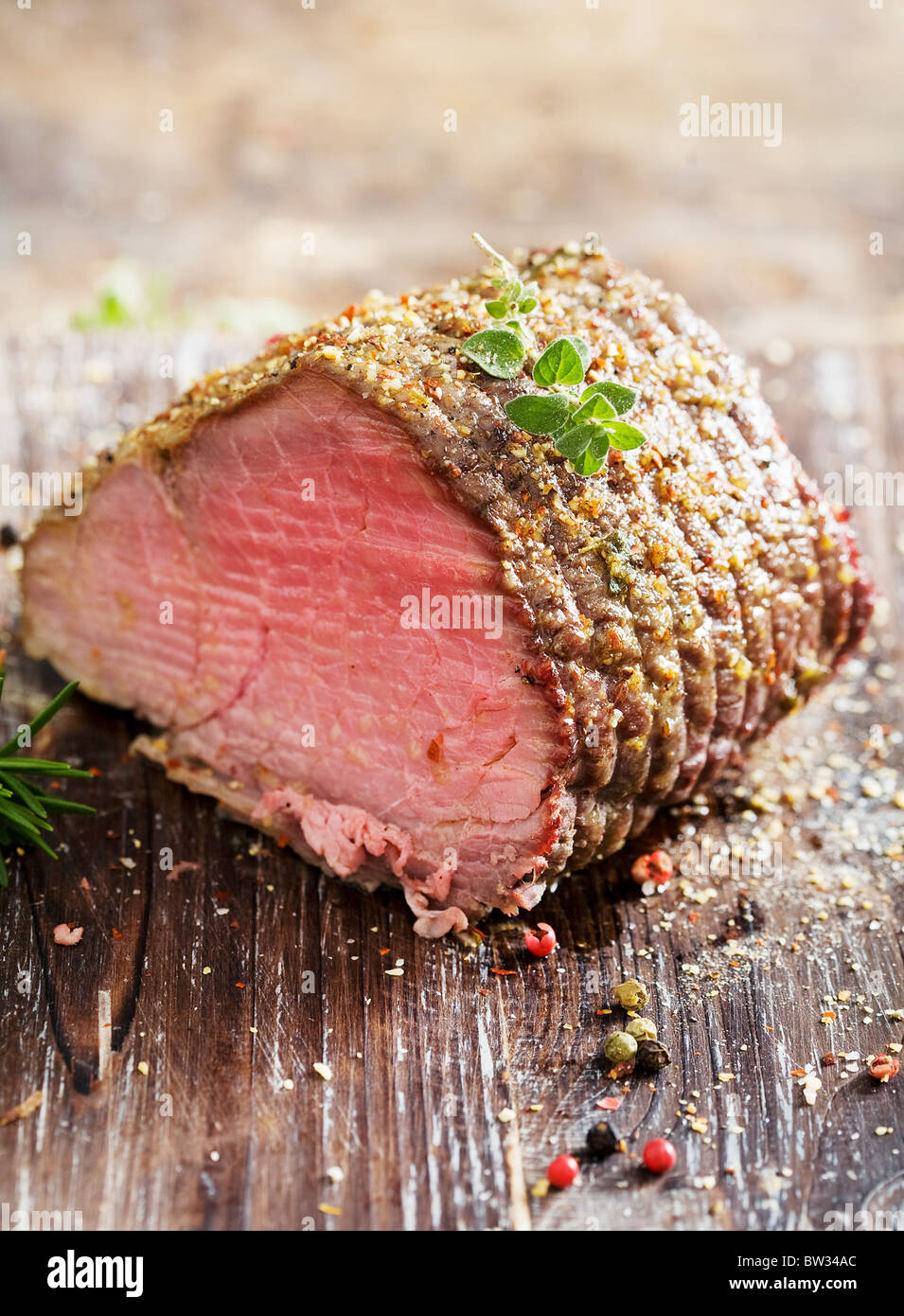 juicy roast beef covered in herbs - Stock Image