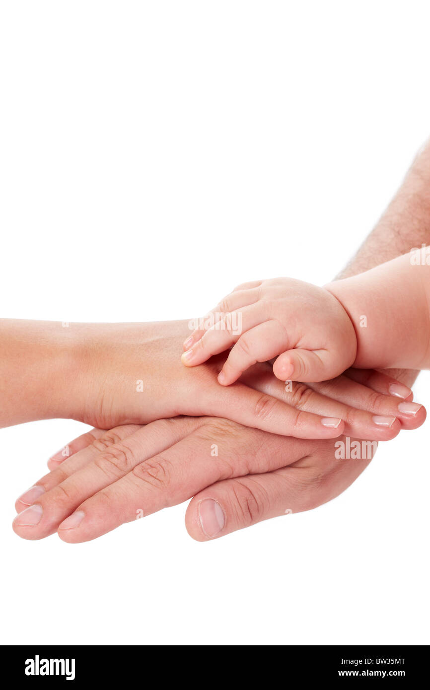 Image of parental palms with newborn baby hand on top - Stock Image