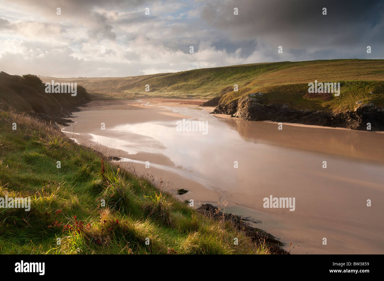 A deserted beach at Porth (Polly) Joke on the North Cornish coast between Crantock and Holywell Bay - Stock Image