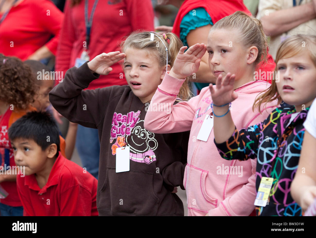 Elementary school children from Texas School for the Deaf show patriotism at the annual Veteran's Day parade - Stock Image