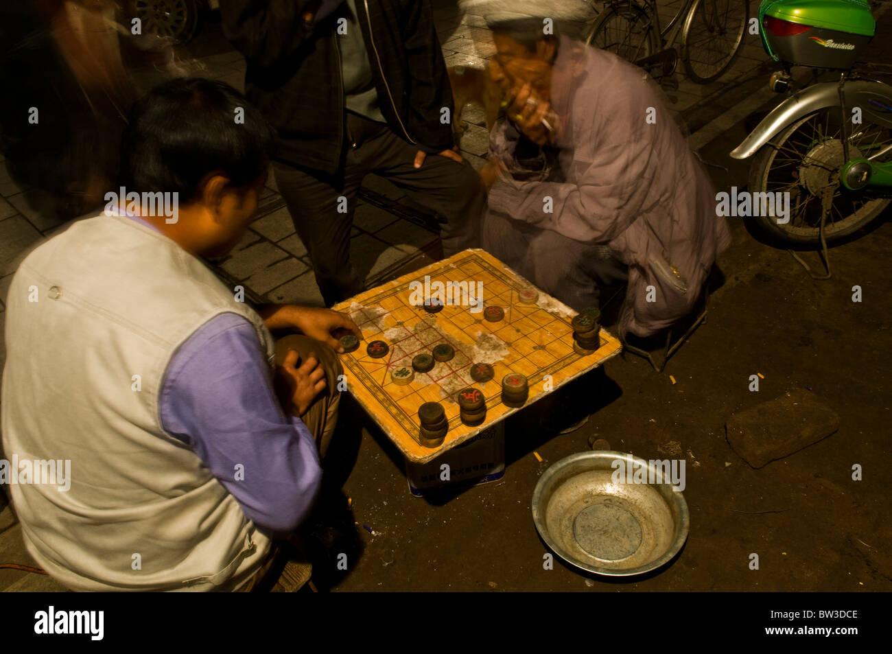 Men playing Xiangqi - Chiness chess. - Stock Image