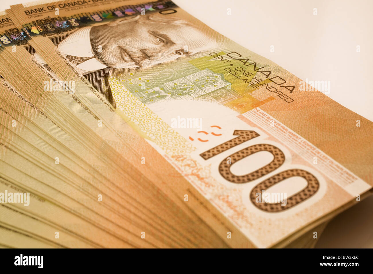 Stack of ten thousand dollars in Canadian one hundred dollar currency - Stock Image