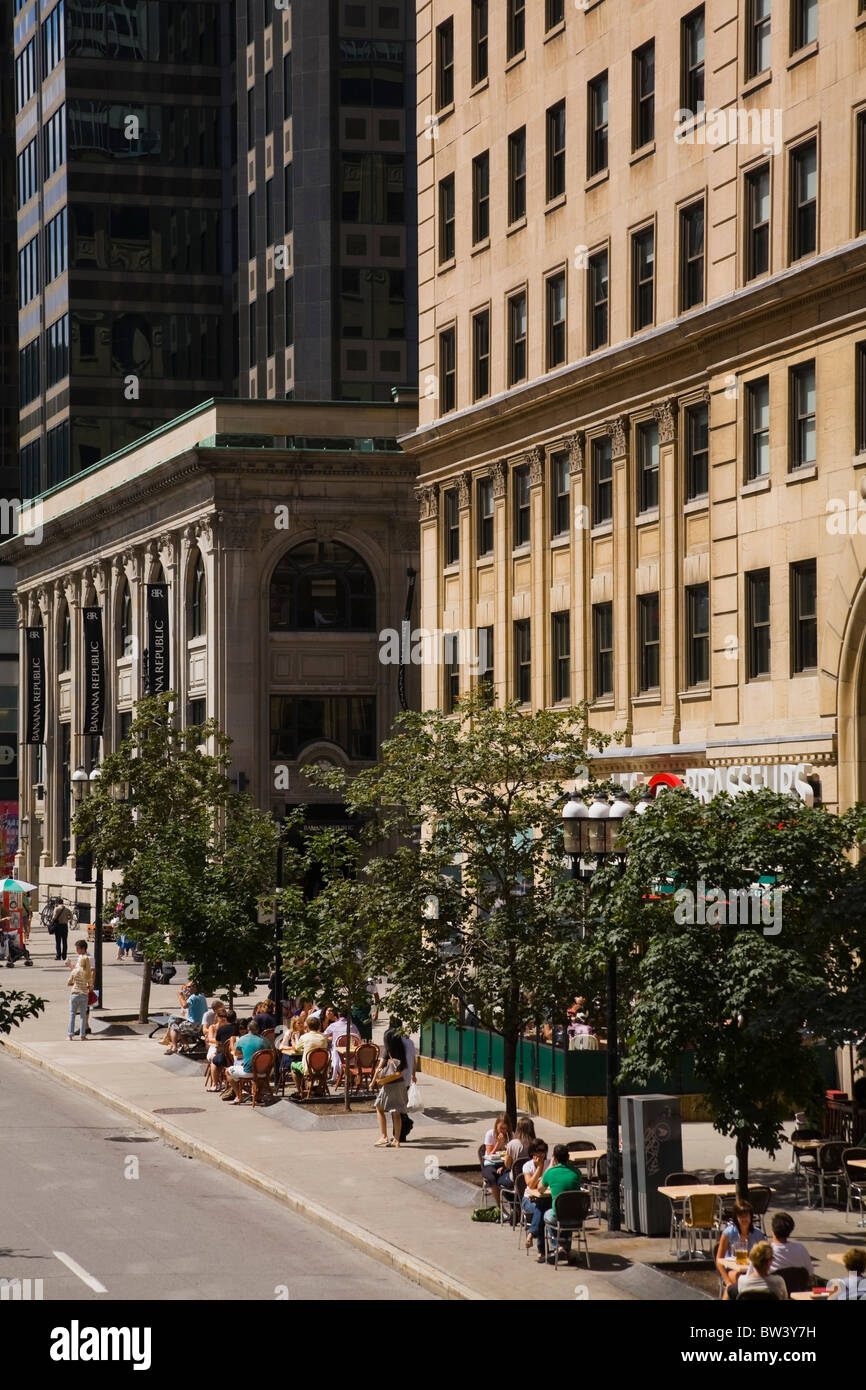 Tourists and locals enjoying the outdoor bistros on McGill College Avenue in summertime, Montreal, Quebec, Canada - Stock Image