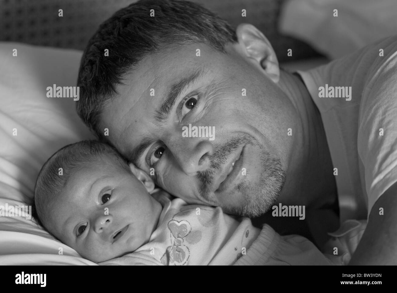 Father's Protection Behavior for his Newborn Daughter - Stock Image