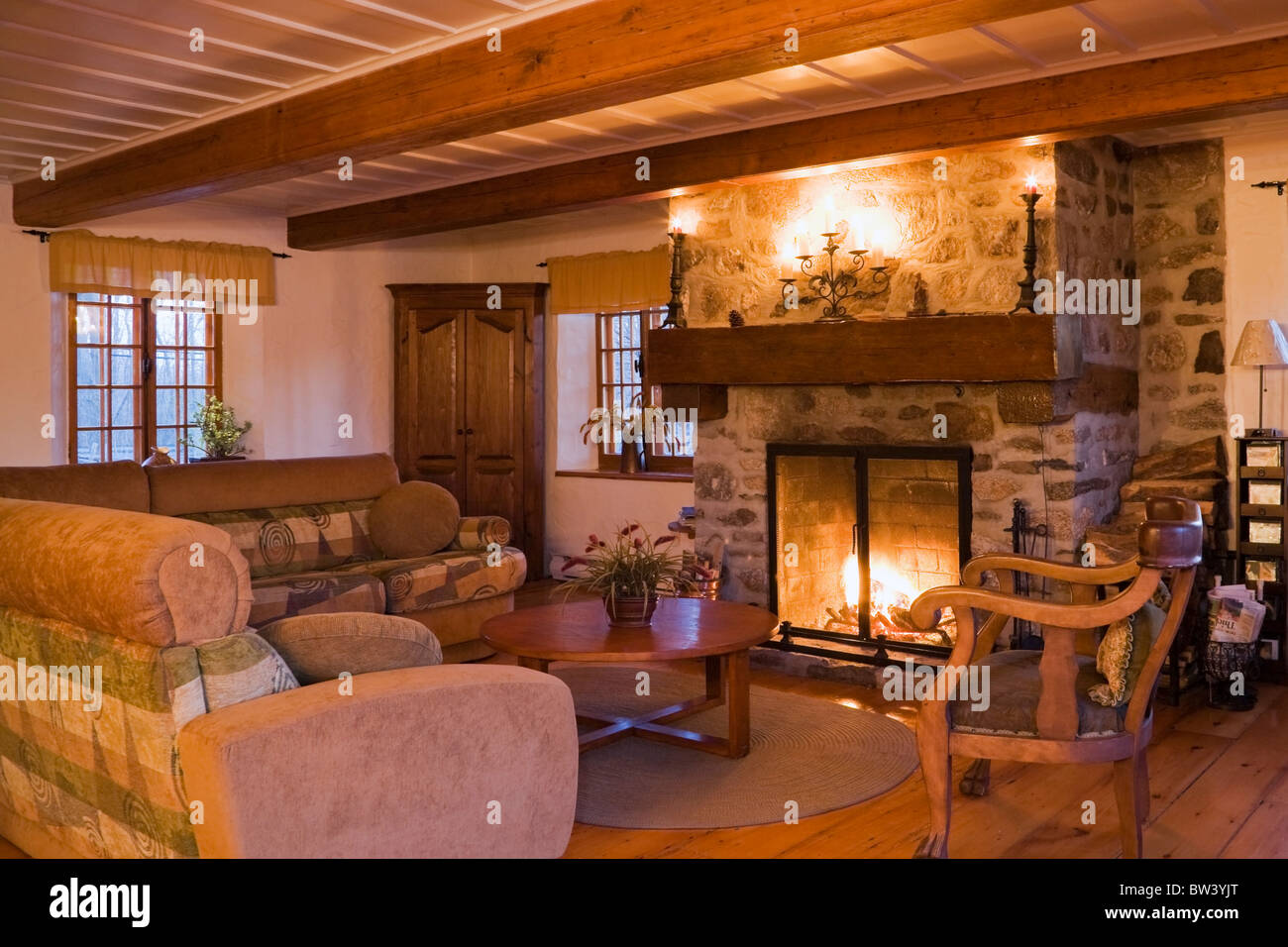 Interior view of the main room in a residential log home, Laval, Quebec, Canada - Stock Image