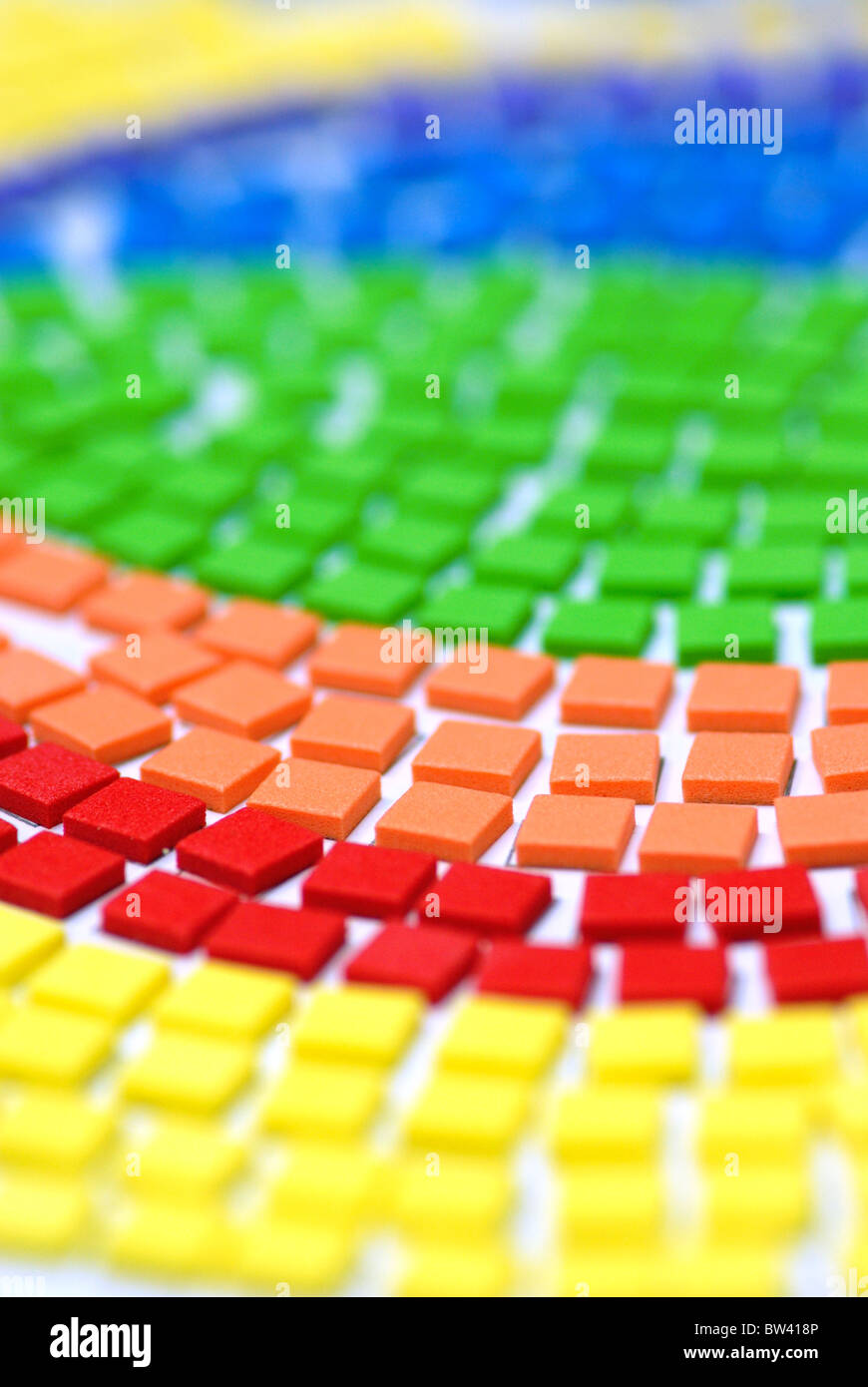 Colorful squares in rainbow colors form a design. - Stock Image