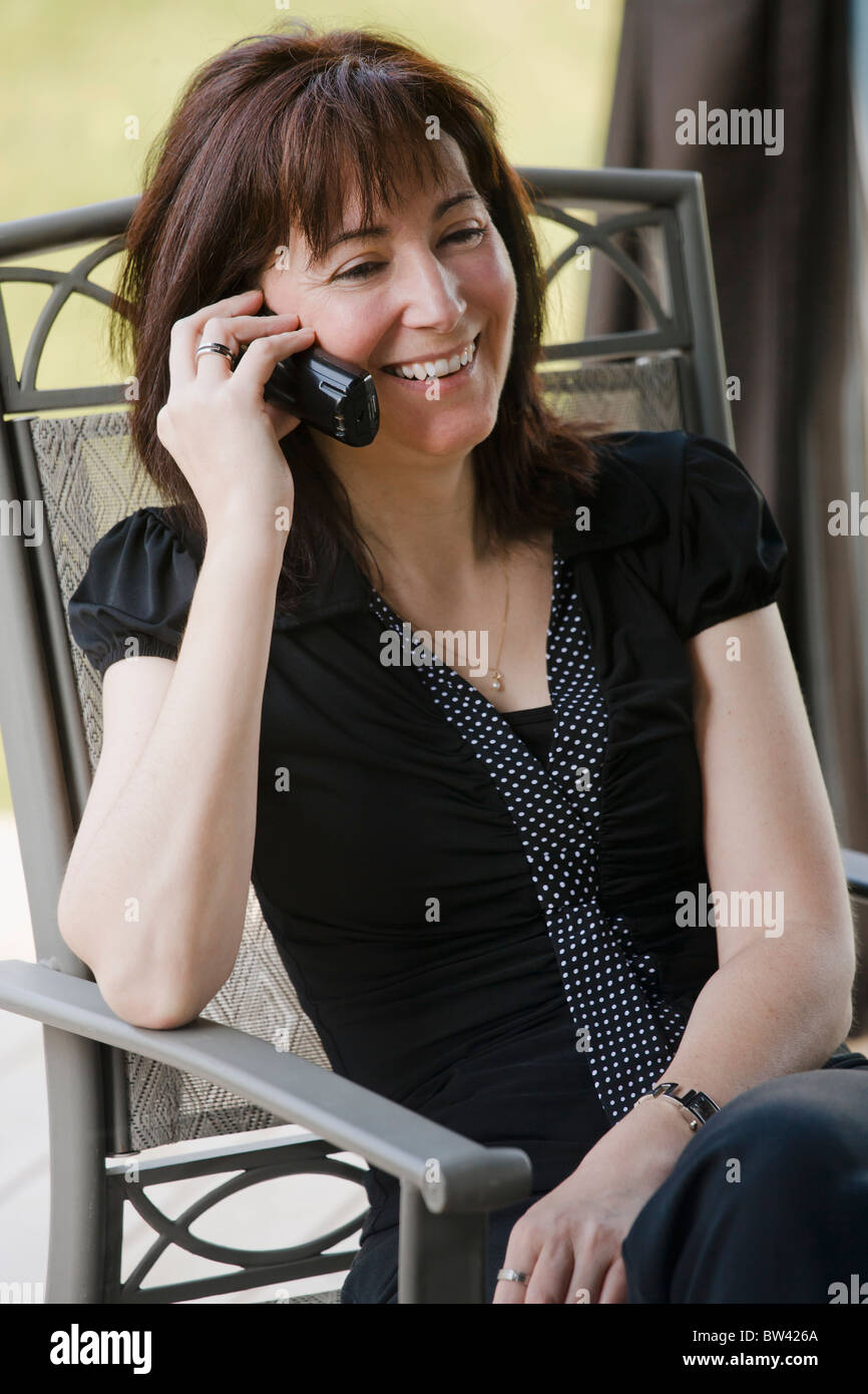Woman talking on a cordless phone - Stock Image