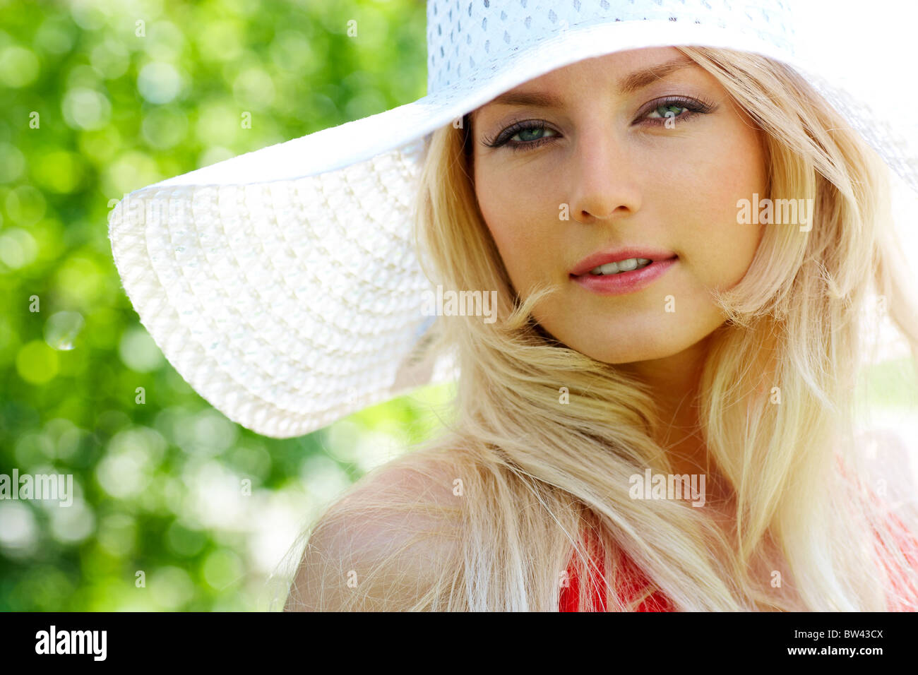 Portrait of pretty young lady in elegant hat looking at camera Stock Photo