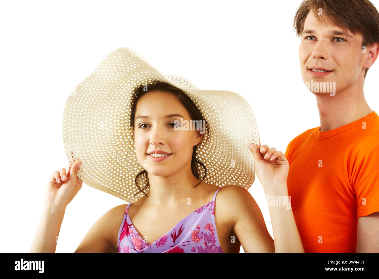 Portrait of elegant girl in hat with handsome man near by on white background Stock Photo