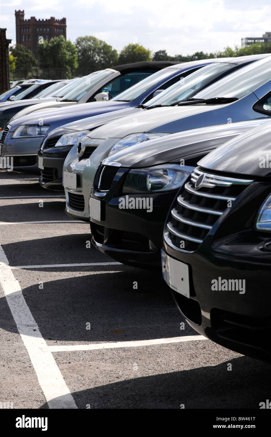 The front of a row of right hand drive cars in car park - Stock Image