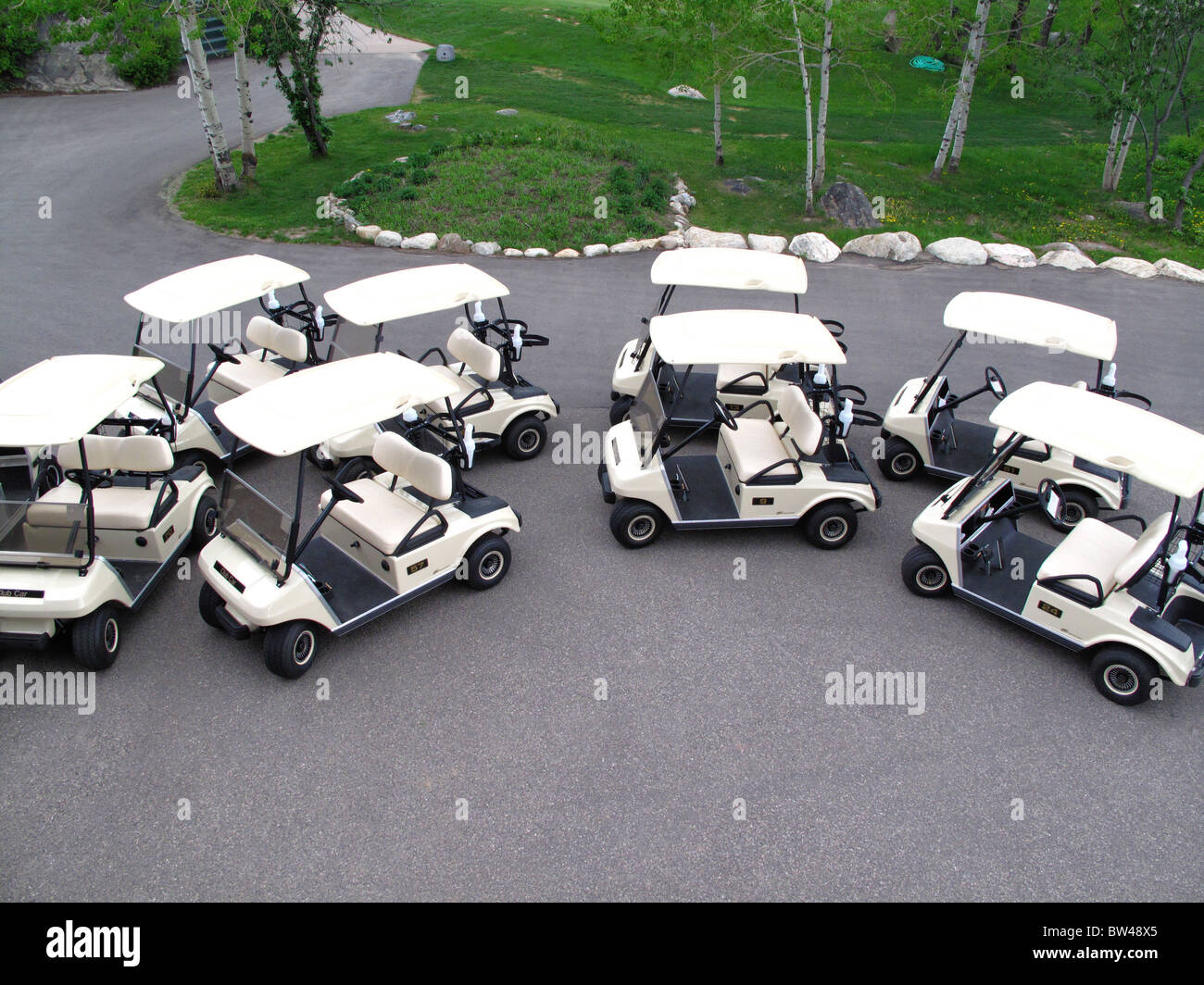 Golf carts parked in preparation for a tournament. - Stock Image