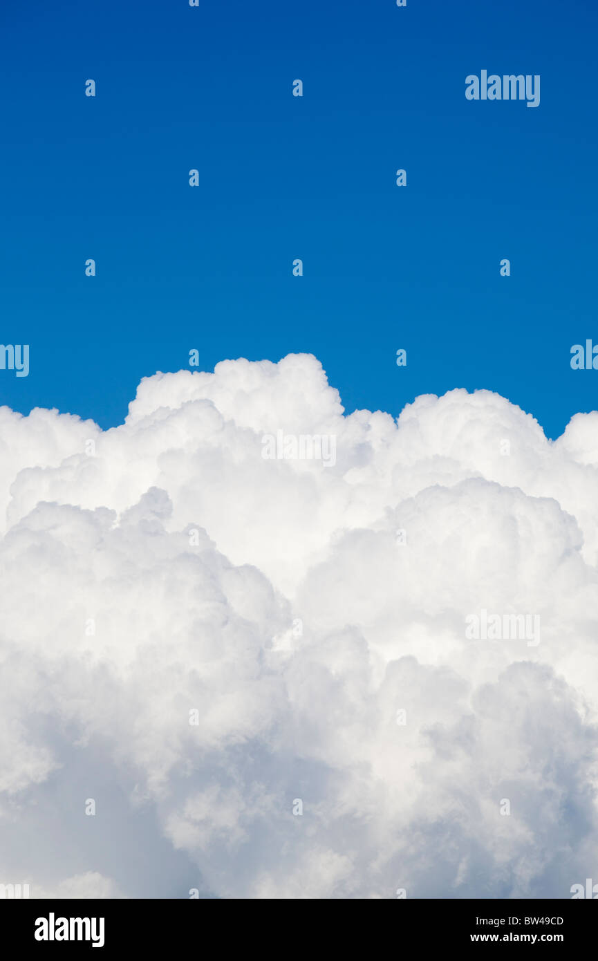 Cumulus cloud front on clear blue sky - Stock Image