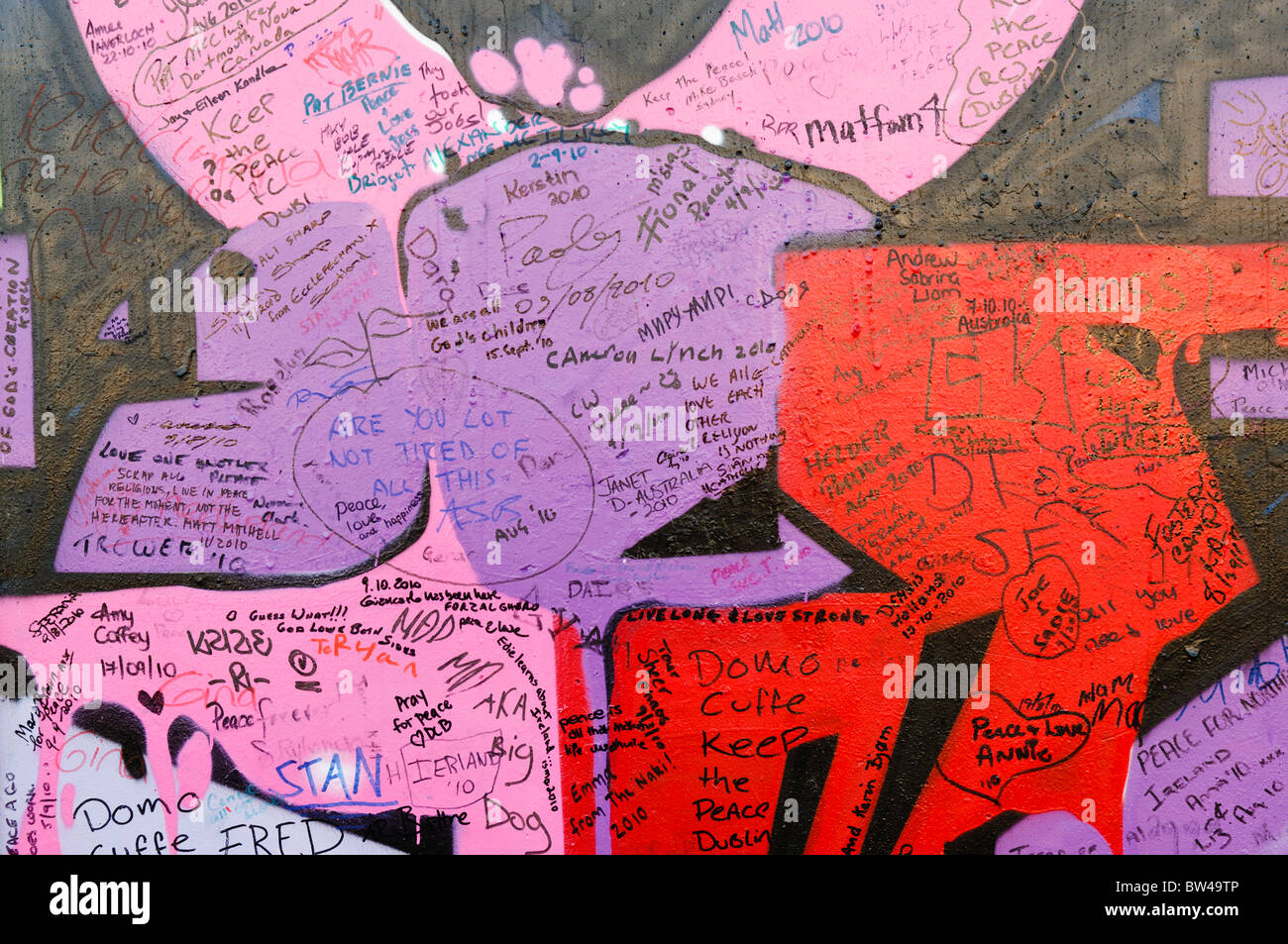 Messages written by tourists on a Peace Wall in Belfast - Stock Image