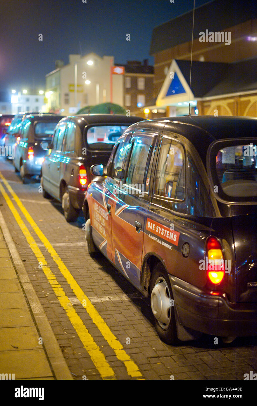 Taxi Cab with BAE Systems advertising in Preston, Lancashire - Stock Image