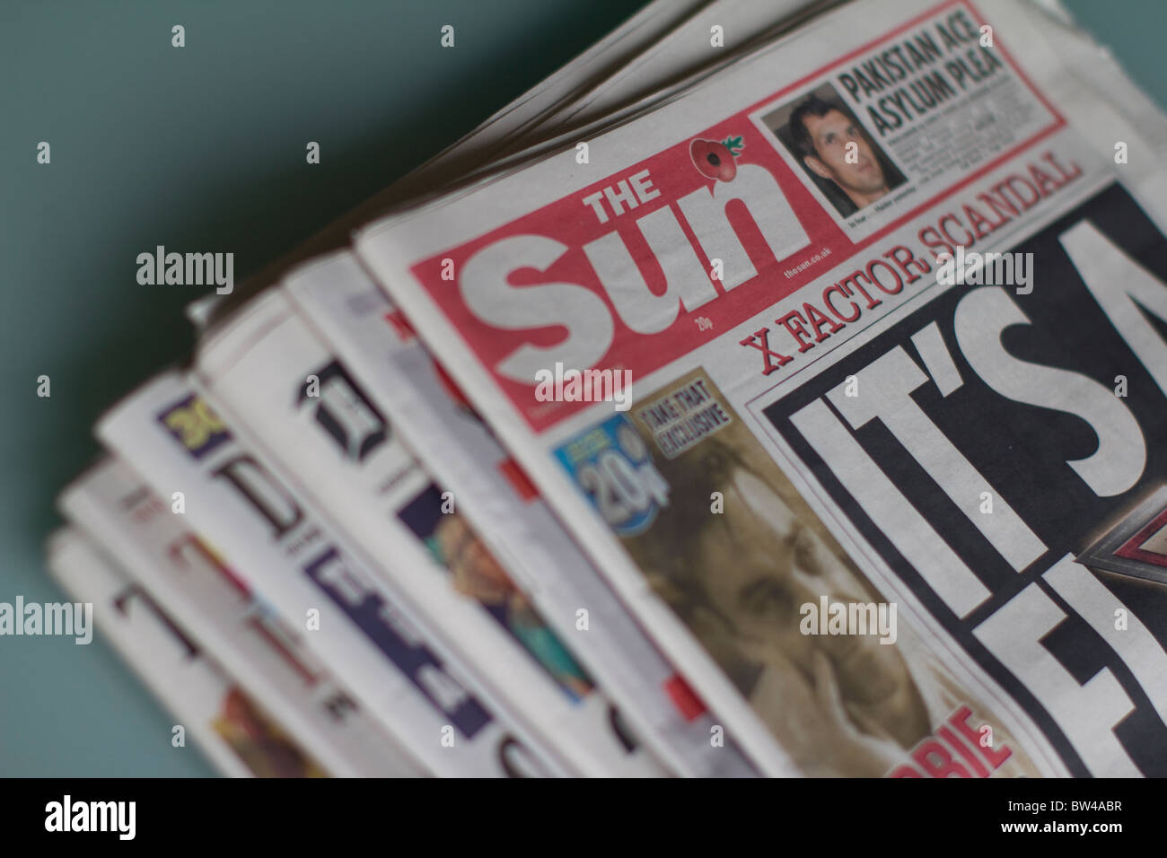 Daily UK tabloid newspaper, the sun, with other popular uk tabloids - Stock Image