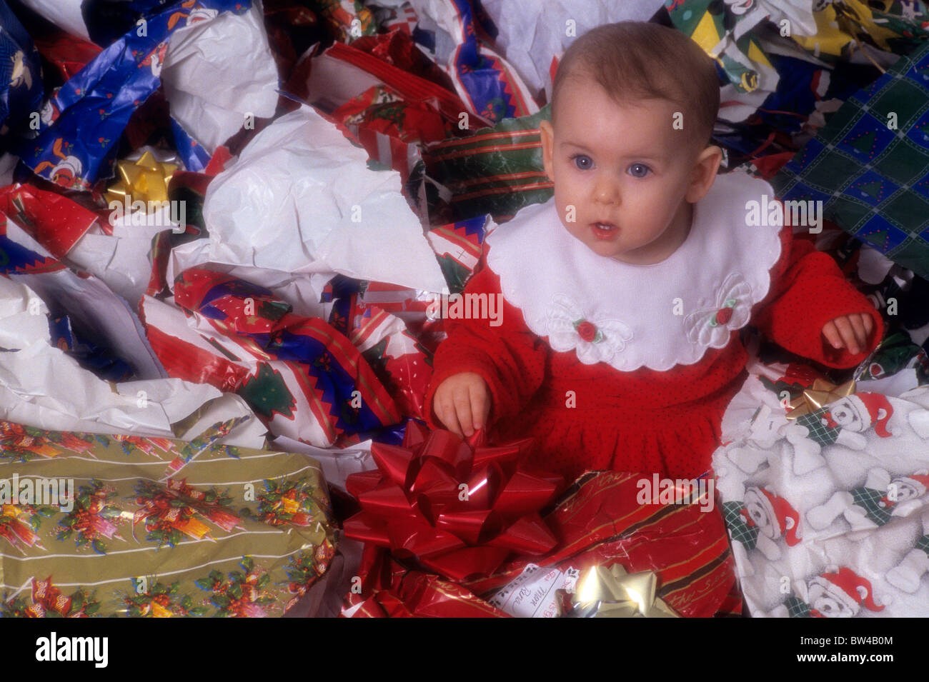 Baby\'s first Christmas playing in wrapping paper after Christmas ...